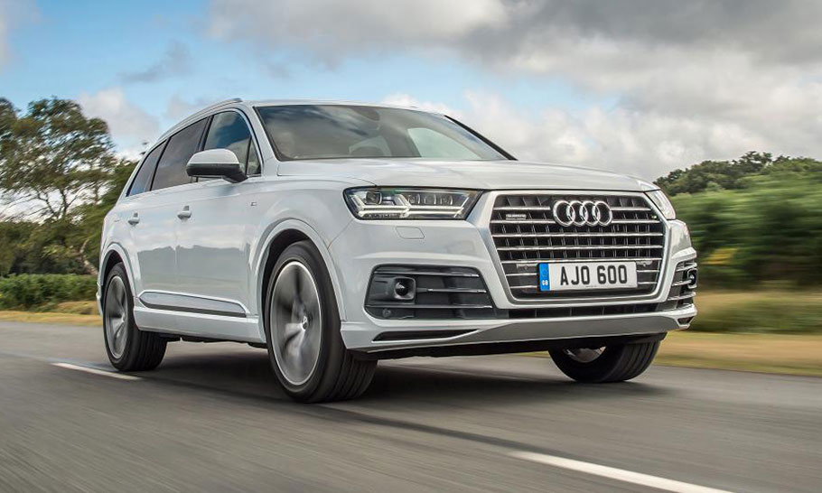 2019 Audi Q7 driving down a road