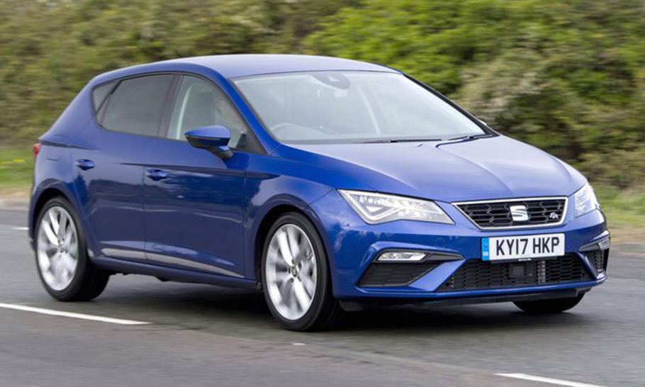 Blue Seat Leon driving down a road